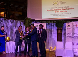Jiji Mammen receiving ADFIAP Award on behalf of SIDBI